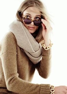 neutral shades and gold link bracelet, and tortoise shades