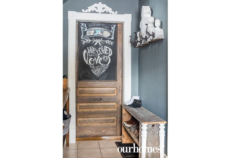 "This sliding door was the home's original front door. The owners refinished it and it now divides the foyer from the dining area. The owners switch up the chalkboard messages on occasion.  @benjaminmoore paint sourced at @heerspaint   See more of this home in ""Decrepit Boarded-up Home Brought to Life in Kitchener"" from OUR HOMES Waterloo Spring 2017: http://www.ourhomes.ca/articles/build/article/decrepit-boardedup-home-brought-to-life-in-kitchener"
