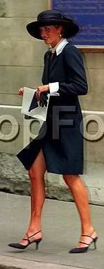 Diana leaving the wedding of her friend Lady Sarah Armstrong Jones showing us a nice bit of bare leg!!! :-)