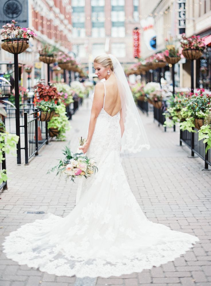 Elegant lace trimmed wedding dress: Photography : Lauren Gabrielle Photography Read More on SMP: http://www.stylemepretty.com/ohio-weddings/cleveland/2016/03/28/timeless-elegant-cleveland-city-hall-wedding/