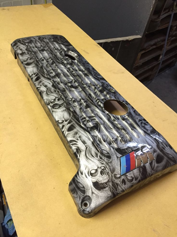 BMW M3 Engine Cover Hydro Dipped in 'hear no evil' skull pattern on silver base coat by Rade Customs