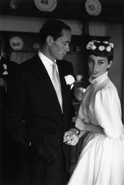 1955, Burgenstock, Switzerland - Audrey Hepburn in a tea-length, chiffon-sleeved Balmain for her wedding to actor Mel Ferrer.