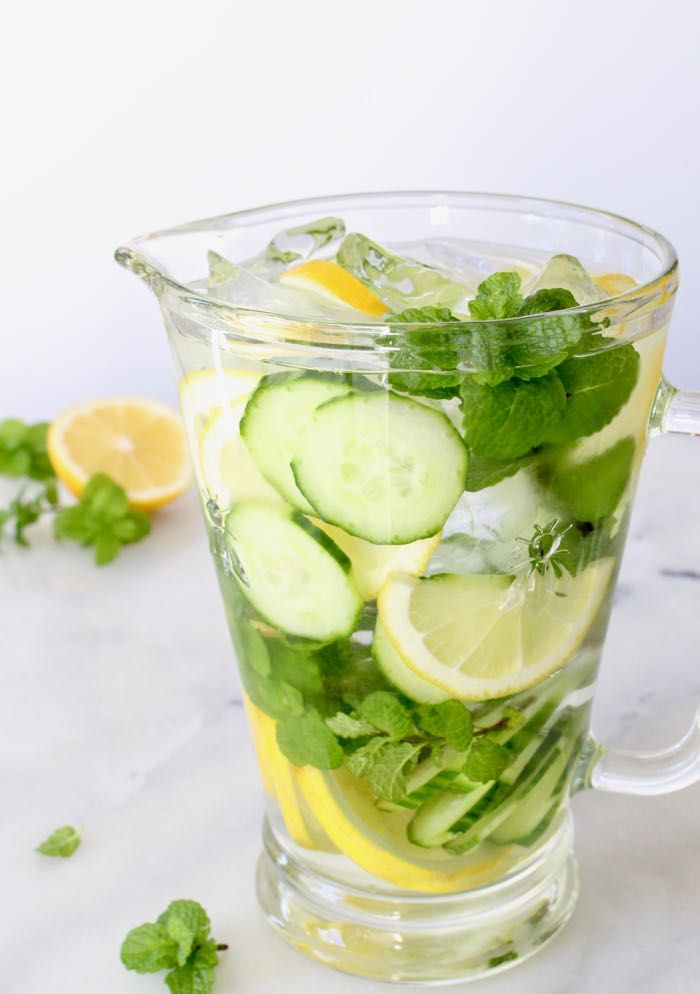 Simple cucumber detox spa water recipe made with fresh lemons, mint or lemon balm + many detox water benefits and ideas.