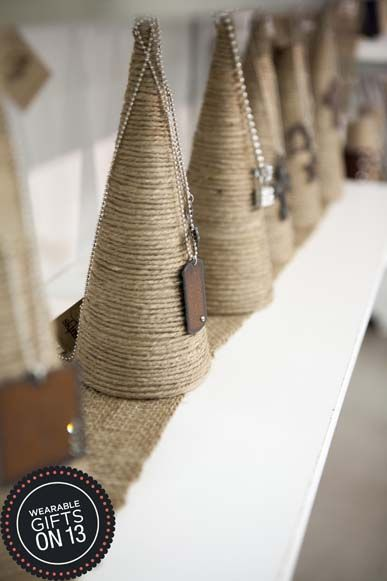 cones covered in twine - bracelet stand idea