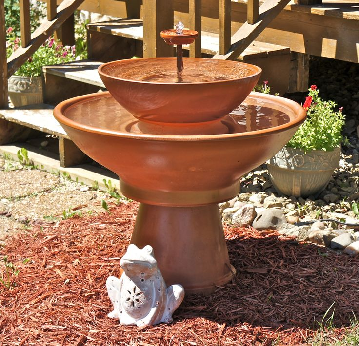 """If you have been looking for a substantial size fountain for your garden, Terra Cotta planters available at your local garden center offer a lot of possibilities and have a pleasing natural outdoor look. The fountain we made for our front garden stands about 32"""" tall from the ground to the very top. The upper bowl is about 21"""" in diameter, and the lower basin is approximately 32"""" in diameter. The fountain holds a generous quantity of water."""