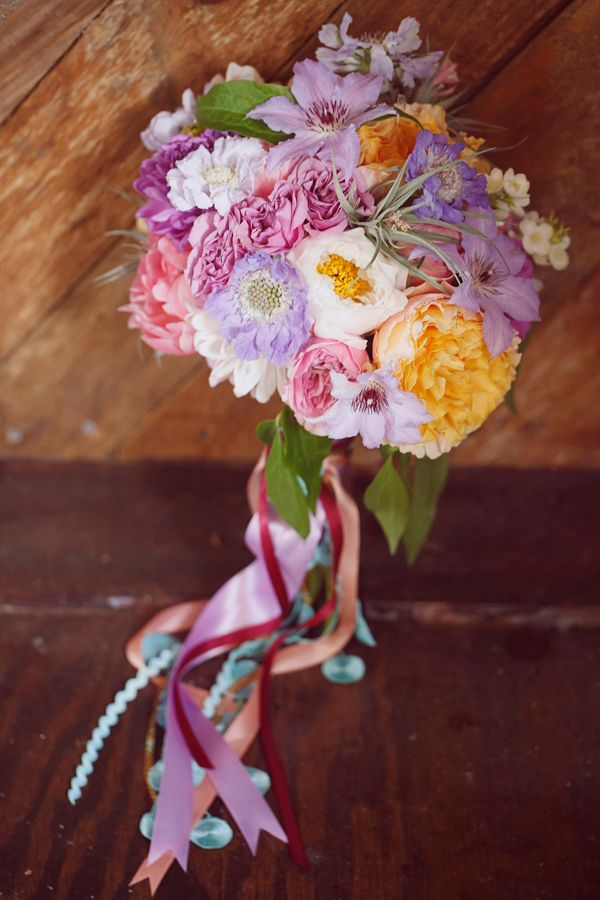wedding bouquet with ribbons, photo by Dreamlove Photography http://ruffledblog.com/bishop-farm-wedding #weddingbouquets #flowers