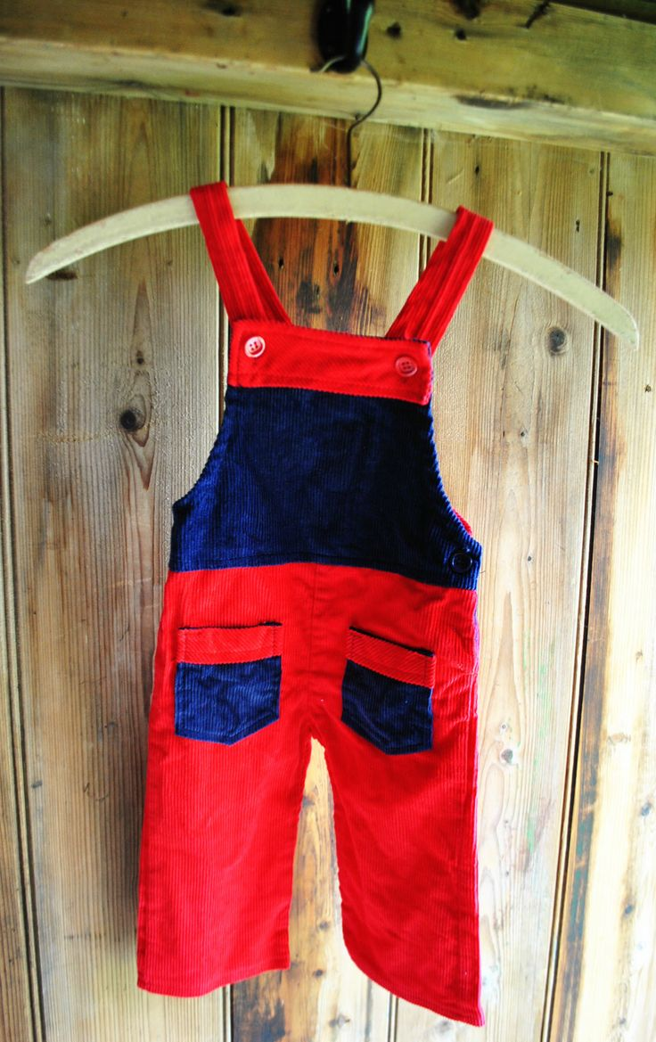 1970s red and blue corduroy dungarees age 12-18months Unworn red and blue corduroy dungarees with pocket detail. Made by 'Puma' £15 Circa: Early 1970s Unworn. Very good condition