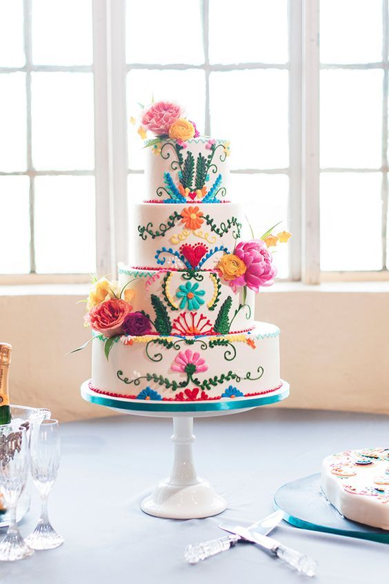 colorful festive wedding cake / http://www.himisspuff.com/colorful-mexican-festive-wedding-ideas/4/ More