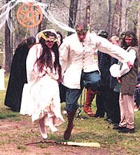 Jumping a broom and sword is a part of tradition for a Handfasting, signifying cutting away negativity and sweeping away past lives!