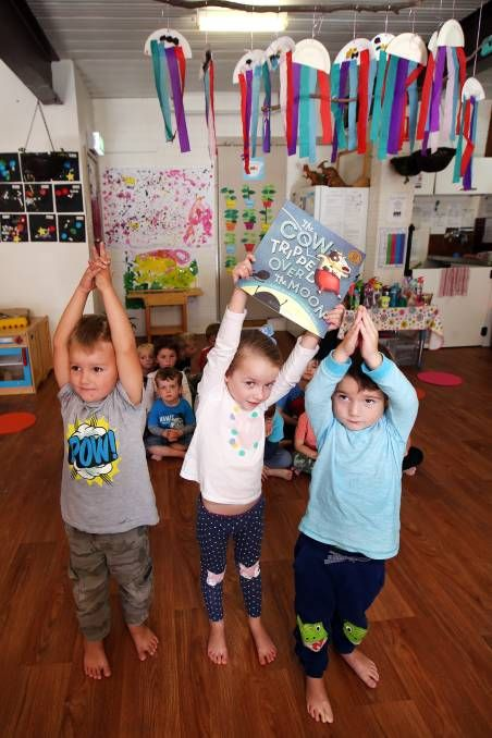YOGA TIME: Kindy Korner preschoolers Patrick, Sienna and Izaac did yoga as part of National Simultaneous Storytime on Wednesday. Picture: Sylvia Liber