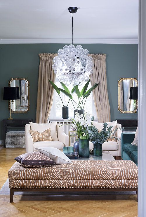 Divine Design zebra ottoman, green living room, palm leaves, Flos Taraxacum 88 by Achille Castiglioni
