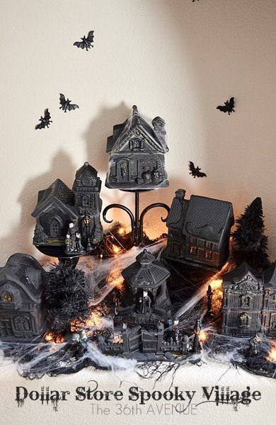 DIY Halloween village made with dollar store Christmas houses! Black paint and glitter!