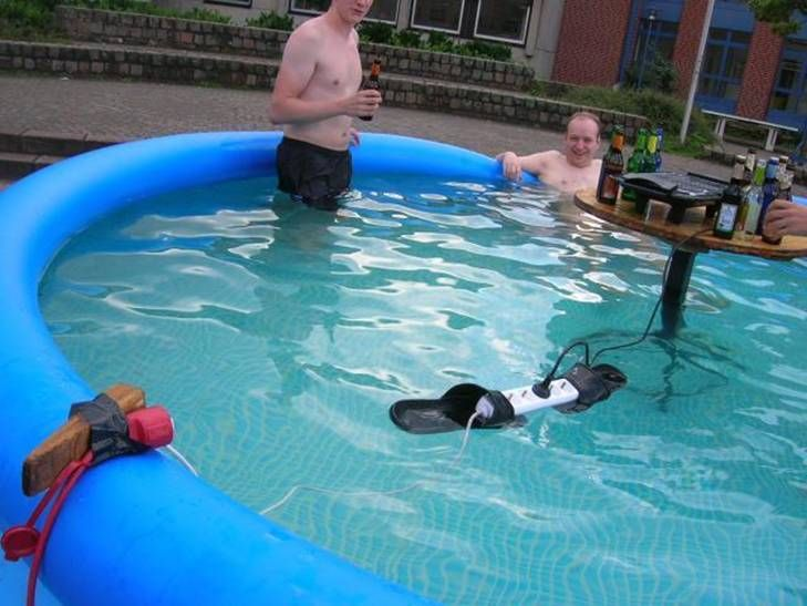 Q) Have you ever wondered what idiots looks like?    A) Well, wonder no more! YES!  That is a POWER CORD Floating on Flip Flops!