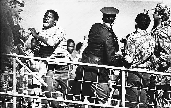 At an army and police roadblock during the Soweto uprising, South Africa--June 1976 Photo credit: Hulton Archive / Getty Images