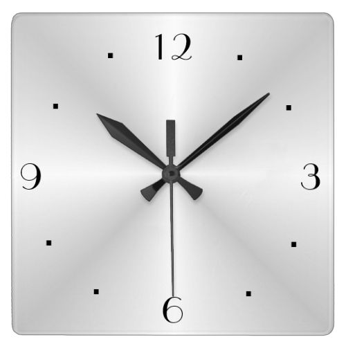 A Very Plain Silver Wall Clock With Black Numerals And Hands Simpistic