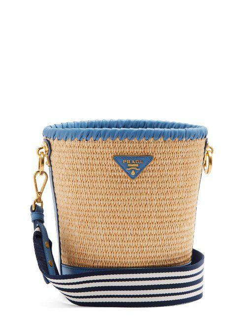 497038b775cf Prada Leather-trimmed woven-raffia bucket bag