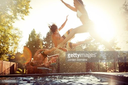 Stock Photo : Three friends enjoying a day at the pool.