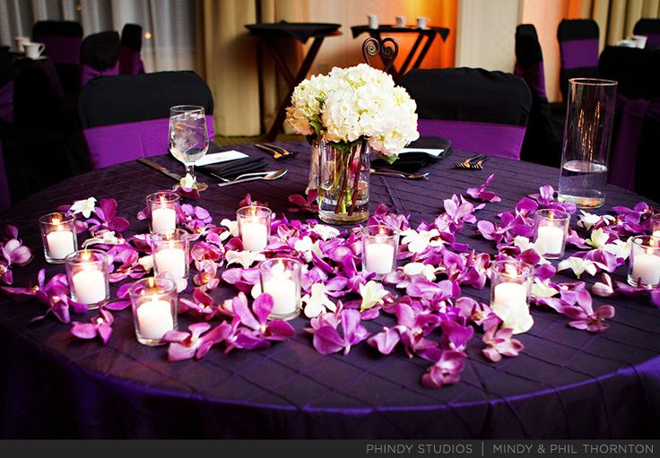 A Small Centerpiece Of White Hydrangea Purple Orchid