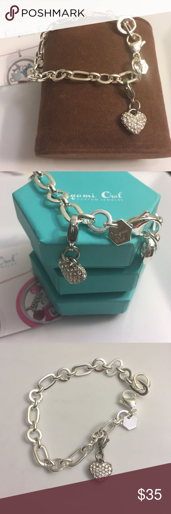 """Origami Owl Bracelet Set Set includes: a 7""""inches bracelet silver tone and a silver tone heart with crystals silver tone. The bracelet also cones with a clasp for you to add small lockets. Original and brand new pieces. Origami Owl Jewelry Bracelets"""