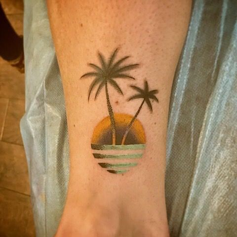 Tattoo done by Enzo Bello at Americana Tattoo in Las Vegas. #tattoo #palmtree #sunset