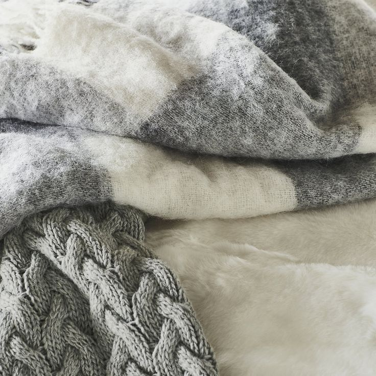Markham Throw | The White Company US. Nothing says cozy better than a super-soft throw, and this one is particularly special. In a gorgeously oversized check pattern in alabaster and gray, it's made from a wool, mohair and alpaca mix making it incredibly fluffy and soft. Shopping from the UK? -> http://www.thewhitecompany.com/Markham-Throw/p/markham-throw?swatch=Grey%2FAlabaster&groupCode=MARKHAM-TH