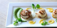 Scallops are wrapped in prosciutto ham and served with watercress and butternut squash purées in this simple yet enticing scallops recipe from Mark Dodson.