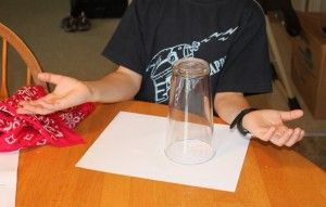 Disappearing coin trick - this is an easy magic trick that kids can do with items from around the house!  Need a glass, paper, penny, and a bandanna.