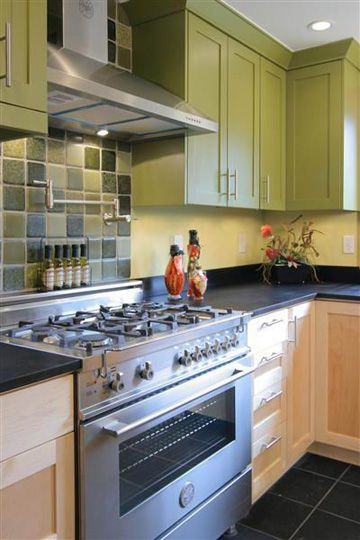 LOVE the green cabinets with the glass tile backsplash from Bedrock