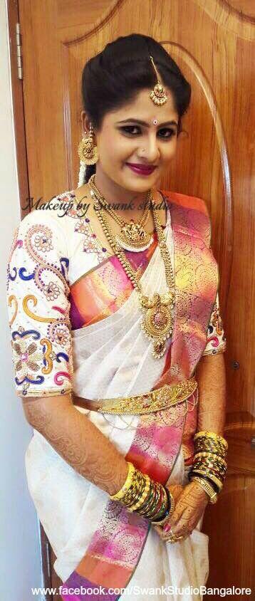 Our pretty bride Deepika is all smiles for her muhurtam. Makeup and hairstyle by Swank Studio. Berry lips. Maang tikka. Bridal jewelry. Bridal hair. Silk sari. Bridal Saree Blouse Design. Indian Bridal Makeup. Indian Bride. Gold Jewellery. Statement Blouse. Tamil bride. Telugu bride. Kannada bride. Hindu bride. Malayalee bride. Find us at https://www.facebook.com/SwankStudioBangalore