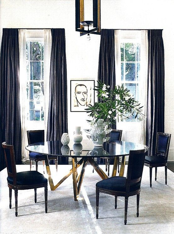 this dining table with brass legs is a beauty. Black & white room.