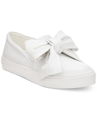 Nine West's Onosha sneakers will add a cute touch to your casual wardrobe with their slip-on styling and oversized bow detail. | Fabric or leather uppers; manmade sole | Imported | Fabric content and