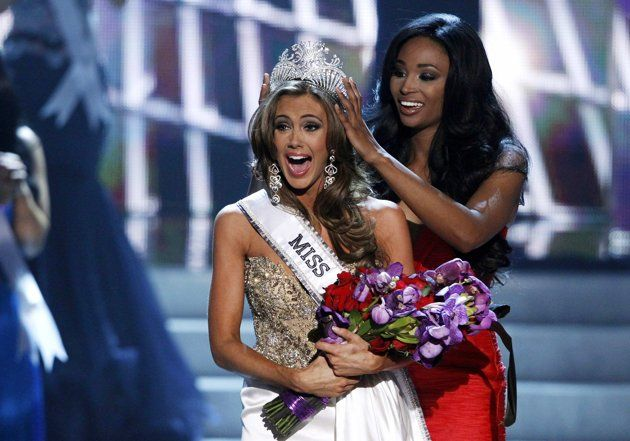 Miss Connecticut Erin Brady reacts as she is crowned by Miss USA 2012 Nana Meriwether during the Miss USA pageant at the Planet Hollywood Resort and Casino in Las Vegas, Nevada June 16, 2013. REUTERS/Steve Marcus.  A 25-year-old accountant from Connecticut with a secret glamorous side is the new Miss USA.