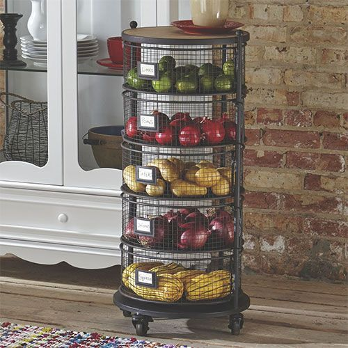 Get creative with how you store some of your kitchen staples. Use metal storage bins to show off fresh produce and colorful linens. It brings an open feel to the space while keeping everything in its own place.
