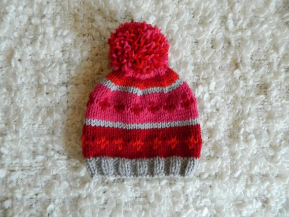 Fair Isle four colored knitted beanie with pompom by RodiAndSuzi, $20.00