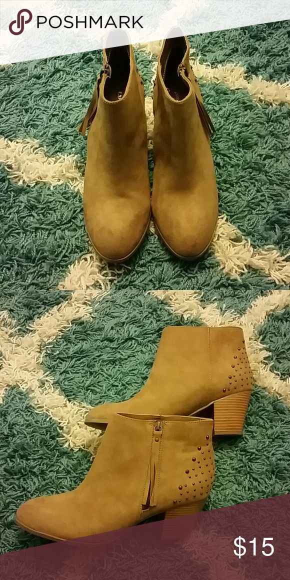 Tan suede ankle boots Tan suede ankle boots with leather tassel side zipper, studded heels, and 1 3/4 inch block heel. Never worn! Express Shoes Ankle Boots & Booties