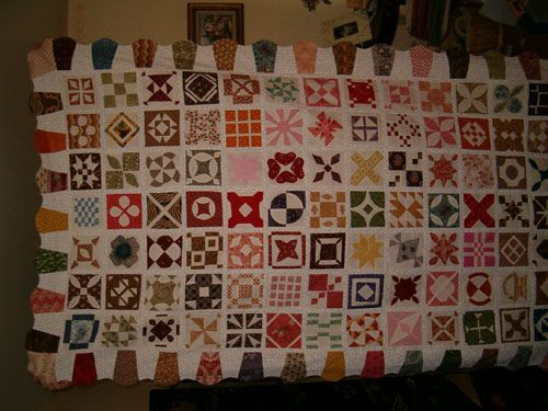 "Here is my twin size version of the ""Dear Jane"" quilt by Jane Stickle. I LOVED making this. I used all Civil War reproduction fabrics. It is my FAVORITE quilt yet that I've made. I've seen the original at the Bennington Musuem in Vermont. Its a beauty."