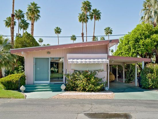 Pink and turquoise mid century ranch house