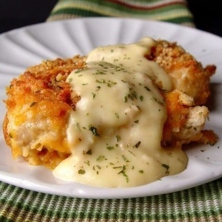 Crispy Cheddar Chicken 2 lbs chicken tenders  2 sleeves Ritz crackers crushed 1/4 teaspoons salt 1/8 teaspoon pepper 1/2 cup whole milk 3 cups grated cheddar cheese  1 10 ounce can cream of chicken soup 2 tablespoon sour cream 2 tablespoon butter
