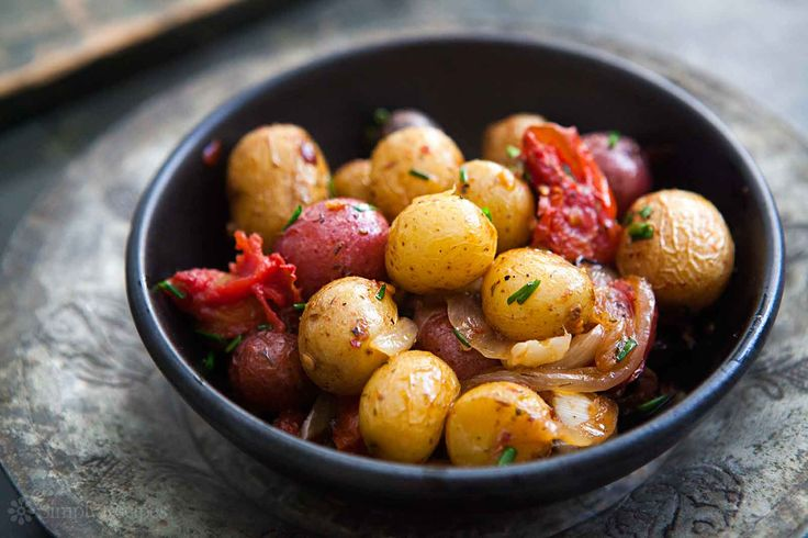 Small new potatoes, roasted with onions, garlic, tomatoes, olives, and herbes de Provence.