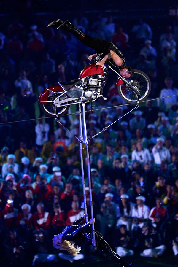 Circus artists perform using a motorcycle during the closing ceremony on day 11 of the London 2012 Paralympic Games at Olympic Stadium on September 9, 2012 in London, England. (Photo by Dennis Grombkowski/Getty Images)