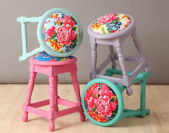 Four colorful bohemian style poufs upholstered with Chinese peony printed fabrics. The beech wood constructions, foam rubber and the fabrics are brand new.
