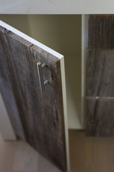 """Cabinet details for facing IKEA cabinets with reclaimed wood: all of the vertical ends are finished with a 45 degree miter to continue the grain. Roché tells us, """"It really makes a difference—instead of fresh-cut raw wood, you see a weathered edge that has a seamless look""""."""