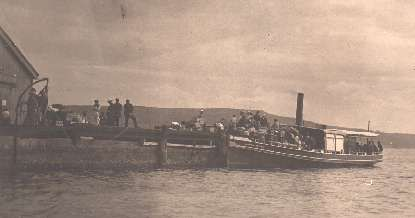 "The steam ferry ""LORNA DOONE"" at the wharf with disembarking passengers."