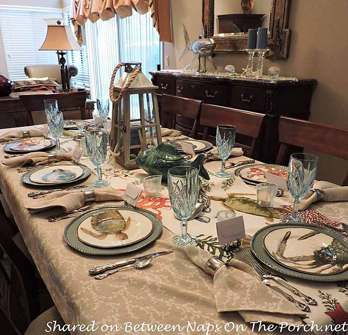 Sea Life Beach Themed Tablescape With Pottery Barn Playa Plates and Table Runner by Between Naps on the Porch.