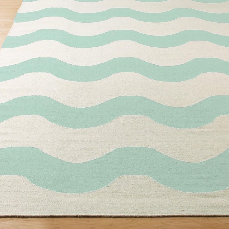 Harmonic Wave Dhurrie Rug - 4 colors Undulating waves of single color and cream weave their way seamlessly into any favorite space from coastal dining to urban sleeping. 100% wool dhurrie construction. Colors: Aqua, Navy, shell Pink or Sand