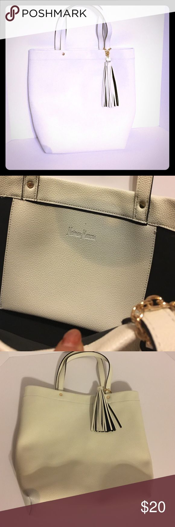 Neiman Marcus tote Cream Neiman Marcus tote, never worn but I did purchase from factory outlet because it has two discolored spots, one on inside pocket and one on exterior corner. Not really noticeable esp when carrying. Neiman Marcus Bags Totes