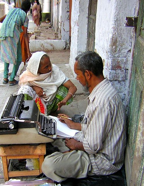 The Letter Writer - About half of India's women are illiterate and need someone to write and fill out forms for them.