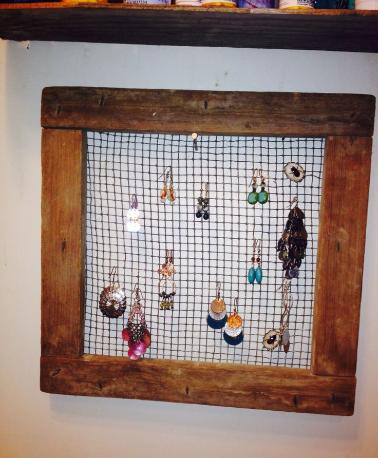 Metal grid framed in wood. Don't really know it's intensional purpose but it's a great earring display