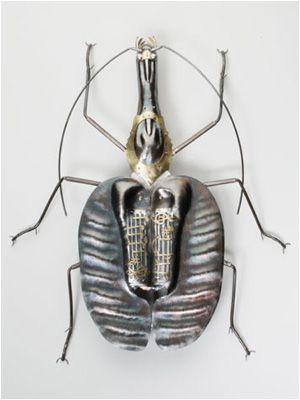 Violin beetle in sterling silver by Elizabeth Goluch, photographed by Steven Kennard