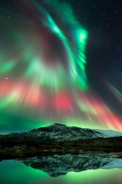 A multicoloured aurora shimmers at Mo i Rana in Nordland, Norway